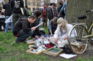 Chris Drew on location Silkscreening at May Day Rally ©nancy bechtol